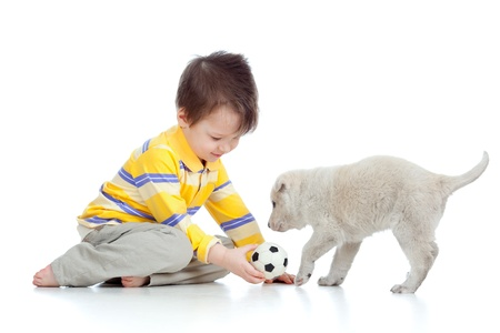 boy ball: adorable boy playing with a puppy Stock Photo