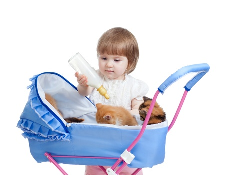 funny child playing with attractive kitten photo