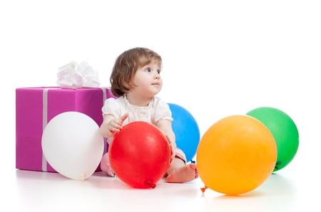 girl  with colorful balloons and gift  Isolated on white  photo