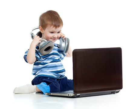 Funny child playing with laptop isolated on white background photo