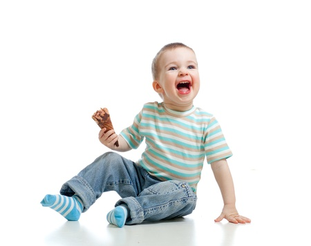 happy child little boy with chocolate ice cream in studio isolated photo