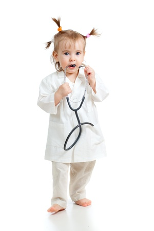 Adorable child uniformed as doctor over white background photo