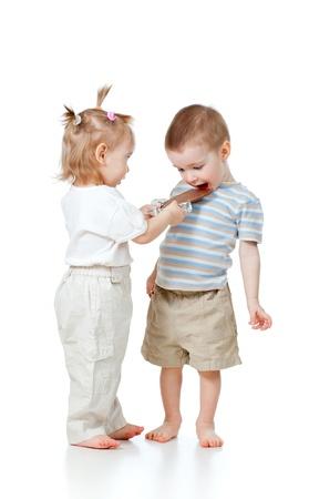 girl entertaining boy by chocolate isolated on white Stock Photo