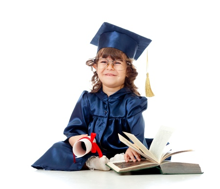 Little girl child in academician clothes  with roll and book photo