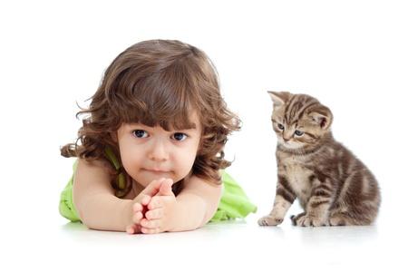 curly headed: Funny child lying on floor  Scottish kitten sitting near girl  Stock Photo