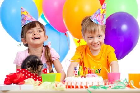 happy children celebrating birthday party with opening gift box photo