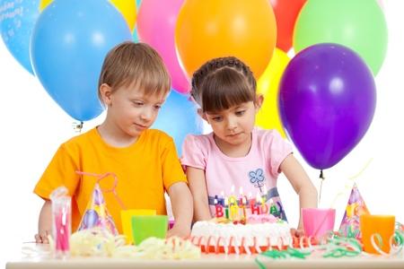 funny children celebrating birthday party photo