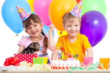festive occasions: happy kids girl and boy celebrating birthday party