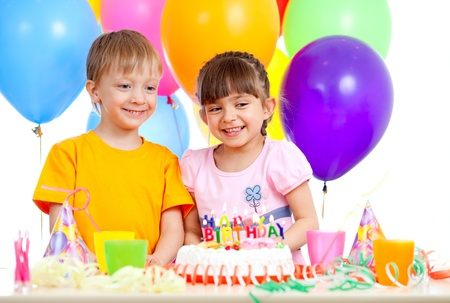 smiling children celebrating birthday party photo