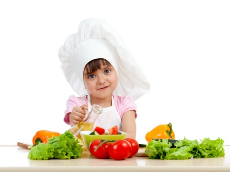 cutting vegetables: Chef girl preparing healthy food over white background Stock Photo