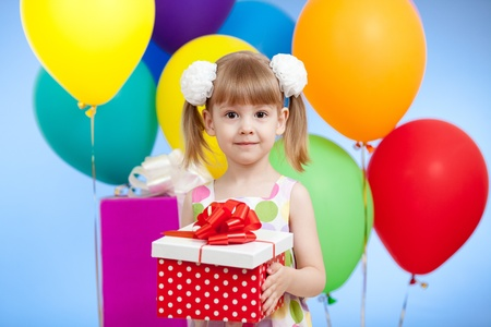 Cute girl  with colorful balloons and gifts Stock Photo - 13550034