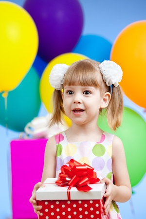 Cute girl  with colorful balloons and gifts Stock Photo - 13550018