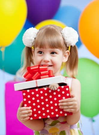 Cute girl  with colorful balloons and gifts Stock Photo - 13550024