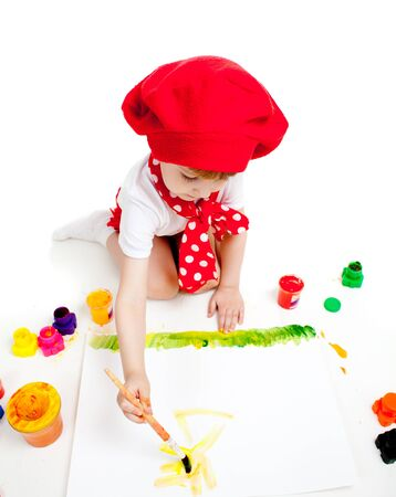 painter girl: small artist child painting with brush Stock Photo
