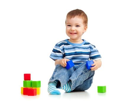 kid playing toy blocks photo