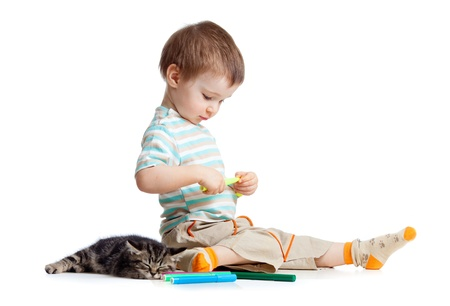 dibujo chico rotuladores con el gato Foto de archivo