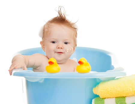 baby kid taking bath and playing photo