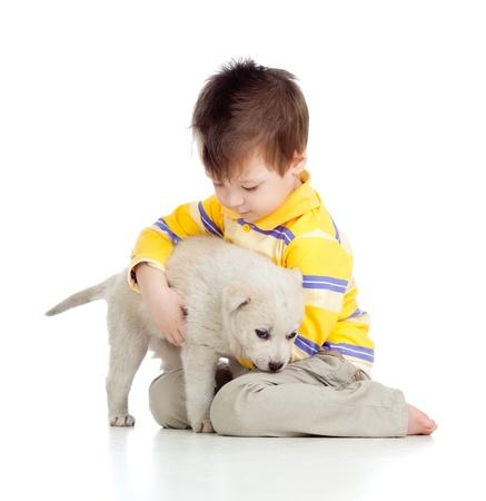 kid hugging puppy on white background photo