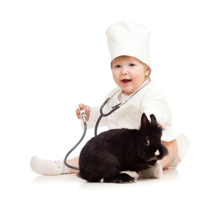Adorable kid doctor with pet photo