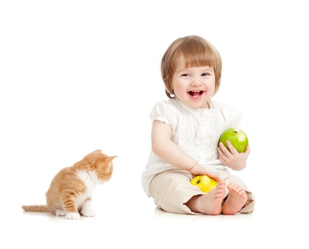 kid eating apples with cat photo
