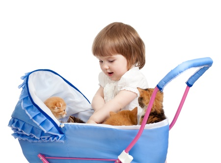 baby carriage: girl with baby carriage and kittens inside Stock Photo