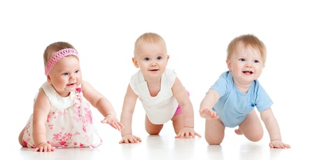 baby crawling: funny baby goes down on all fours