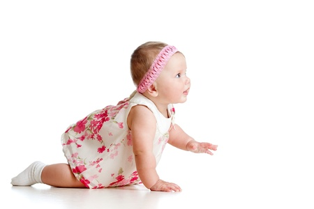side view of pretty baby girl crawling on floor Stock Photo - 13702075
