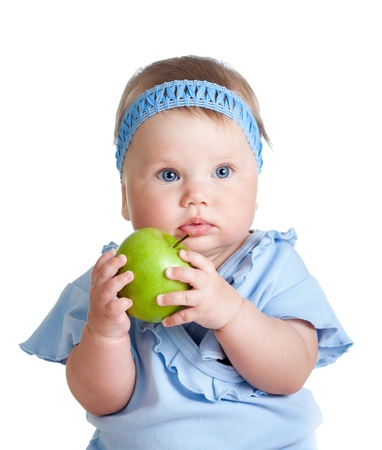 Baby girl holding green apple, isolated on white photo