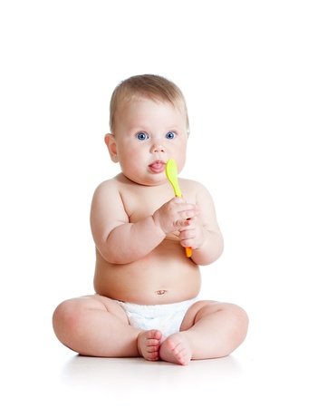 Little baby girl with a spoon photo