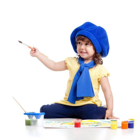 adorable artist kid girl drawing and painting photo
