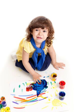 Cute artist kid drawing and painting  Top view of girl  Stock Photo - 13758940