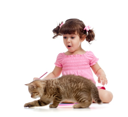 Cute kid drawing with pencils  Kitten next to girl Stock Photo - 13758799