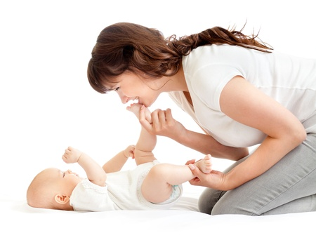 joyful mother playing with her baby infant Stock Photo - 13944567