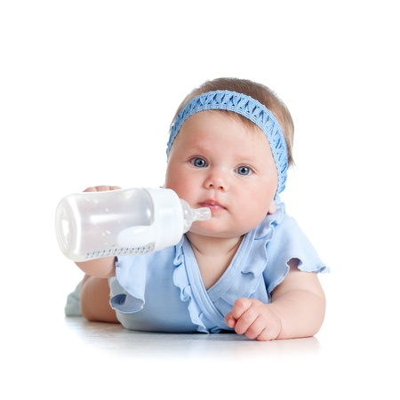juice bottle: adorable child drinking from bottle  8 months old girl  Stock Photo
