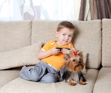 couple couch: kid with loving dog york Stock Photo