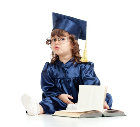 Emotional funny child in academician clothes  with book photo
