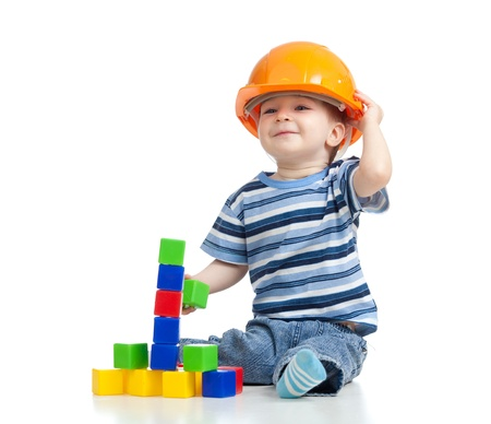 children playing with toys: kid playing with building blocks toy