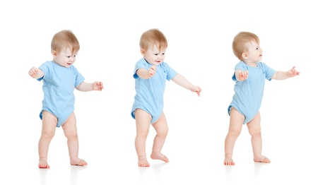 the first step: First steps of baby isolated on white background Stock Photo