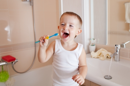 Boy cleaning teeth in bathroom Stock Photo - 14105282