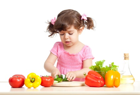 cutting vegetables: Little girl cutting vegetable for salad  Concept of healthy food