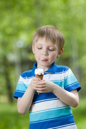 happy child eating a tasty ice cream outdoor photo