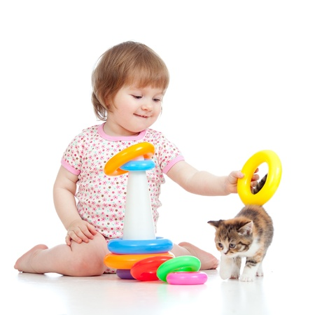 adorable child playing with kitten photo