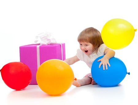 Kid with colorful balloons and gift  Isolated on white  photo
