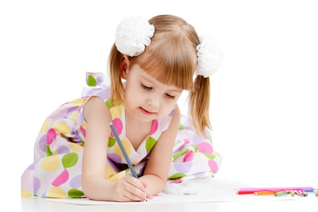 child drawing: adorable kid drawing a picture with color pencils Stock Photo