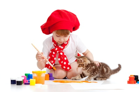 painting child girl with playful kitten photo