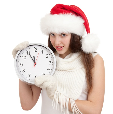 Cute girl in Christmas red santa hat with clock over a white background Stock Photo - 14105316