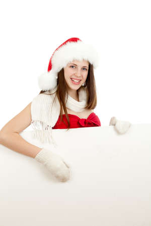 young girl in red santa hat  with billboard isolated on white background photo