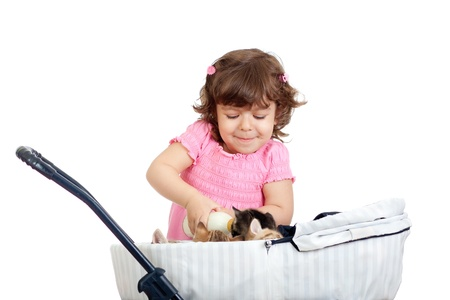 child playing and feeding kitten Stock Photo - 14105327