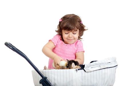 child playing and feeding kitten Stock Photo - 14105327