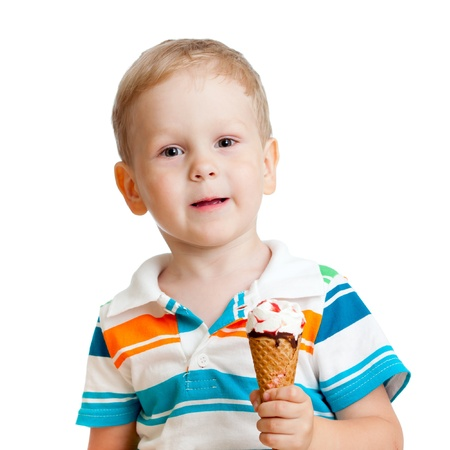 happy child eating ice-cream in studio isolated photo